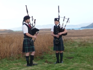 Two lone pipers on Remembrance Sunday on Mull