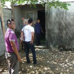 The space where a church building will be constructed between two houses in Southville, PHILIPPINES