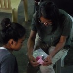 Malou teaching origami in the children's home on Palawan island