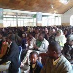 The day after we arrive, hundreds attend the Sunday morning meeting in Ginci, outside Addis Ababa.