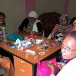 Malou teaching needlecraft skills to some ladies from the Ethiopian church